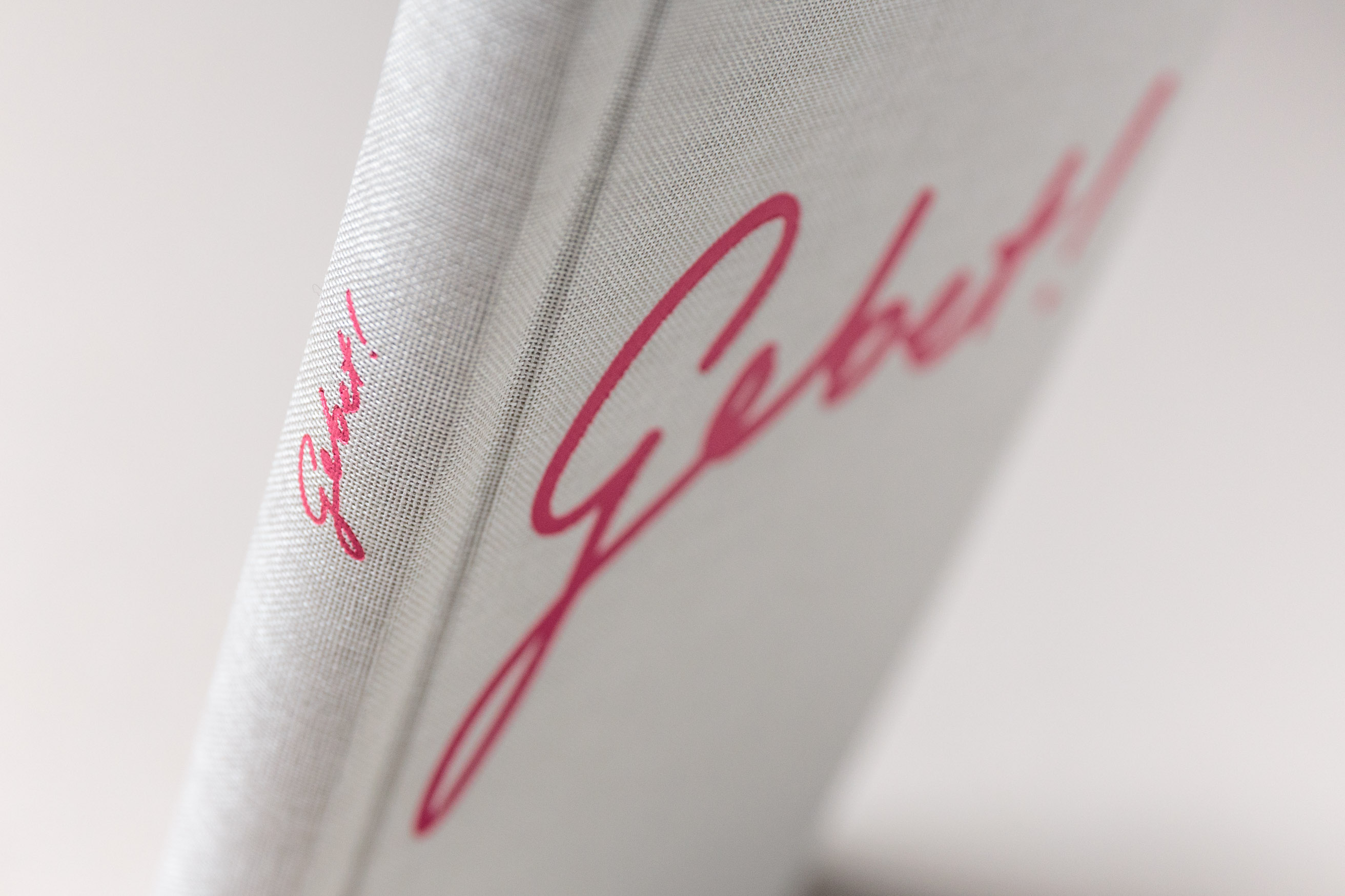 "Book cover: Embossing and a warm grey linen binding – ""Gebet!"" is a prayer book for the scholars of the German Episcopal foundation Cusanuswerk. Set in Freight Text, with Pantone spot color, embossing, linen binding and handwritten content. Designed by Johannes Pistorius"