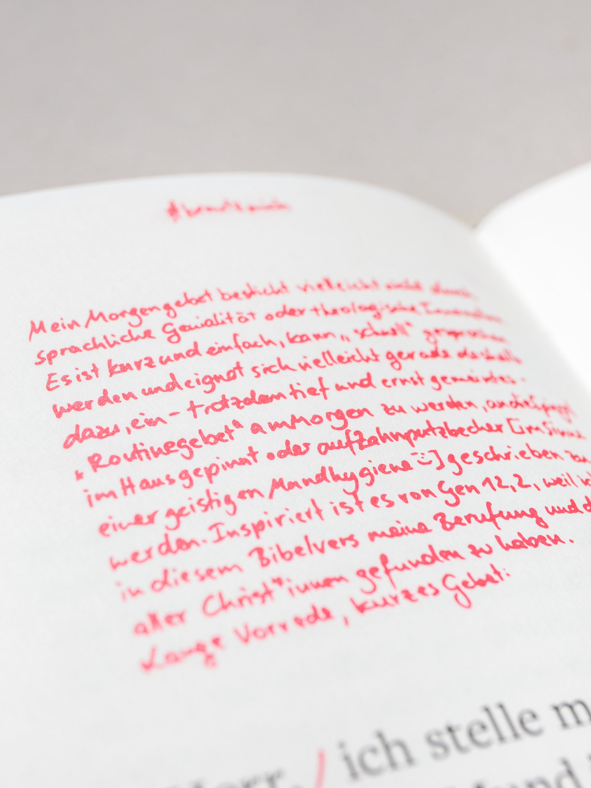 "Handwritten text inside ""Gebet!"", a prayer book for the scholars of the German Episcopal foundation Cusanuswerk. Set in Freight Text, with Pantone spot color, embossing, linen binding and handwritten content. Designed by Johannes Pistorius"
